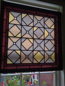 Opalescent Geometric Stained Glass Window