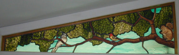 Squirrel and Birds in a Custom Stained Glass Transom Window